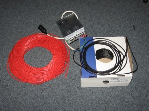 Spools of red and black wire with a power supply